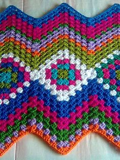 first granny squares and then the ripple stitch