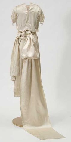 White satin gown with train. Trimmed with Brussels or Bruges duchesse lace. Worn for Dec.18, 1920 wedding.