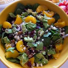 "Cranberry, Glazed Walnut, Orange, Avocado, and Blue Cheese Salad | ""A festive salad for those special holiday meals is easy to make, and combines the bright fall flavors of cranberries, orange, glazed walnuts, and blue cheese. Avocado adds an elegant touch."""
