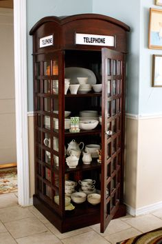 Telephone booth turned china cabinet-- yes!