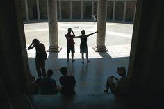 Tourists frolicking in the Palacio de Carlos V, the Alhambra, Granada, Spain