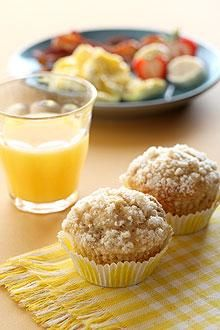 Moist banana apple muffins are crowned with a light sugar-crumb topping.