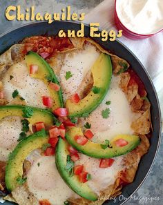 Chilaquiles and Eggs | Eggs, tortilla chips, a robust tomato sauce and slices of avocado make up this delicious Mexican breakfast.