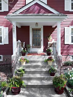 For an easy home update, line steps with potted plants. More ways to boost curb appeal: http://www.bhg.com/home-improvement/exteriors/curb-appeal/make-a-better-first-impression/#page=5