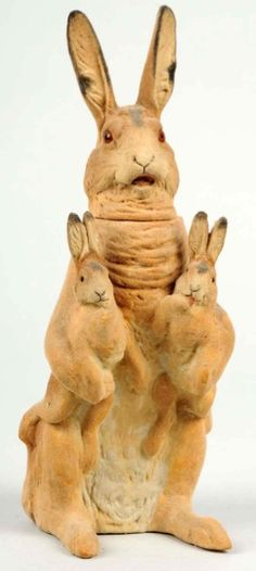Papier mache rabbit candy container with two bunnies.