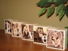 5 wooden squares with pictures of the couple decoupaged on spelling out LOVE with a heart superimposed over the last photo.