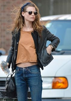 A fresh-faced beauty: The brunette model proved that no make-up is necessary for this confident stunner angel, model, woman fashion, outfit, behati prinsloo, men fashion, street styles, leather jackets, style guides