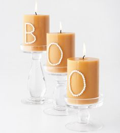 Glue beads, beans, etc onto dollar store pillar candles to spell out spooky words