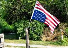The Stars and Stripes fly upside-down outside the rural Bartonville home of Art Palmer. He says his protest, which has generated complaints from veterans and a call to police, signifies distress over politics and policies that fly in the face of the Constitution.