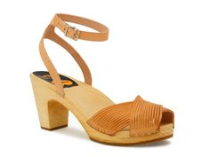 swedish hasbeens strappy leather clog sandals. we are loving this natural brown for this season. it's all over j.crew, madewell, just to name a few of our favorites. these heels are stylish and comfortable to boot. perfect with shorts and a casual top for a day at the beach, or that vena cava skirt!