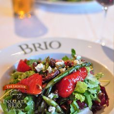 Mixed greens, roasted red peppers, grilled asparagus, tomatoes, Gorgonzola, grapes and candied pecans tossed with Italian vinaigrette