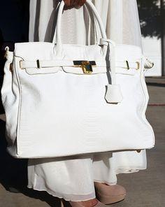 get a white purse... I have NEVER had one !!  hahahaha ... WEIRD !