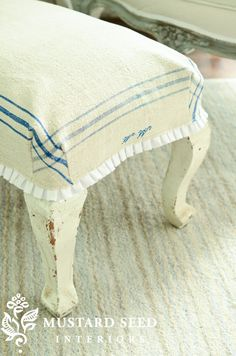 Tutorial on making a small ottoman/stool cover out of a vintage tea towel, some trim and a little sewing...