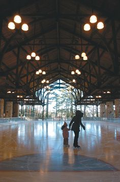 Charlotte Burrows, 4, skates around the ice in the Mohonk Mountain House's pavillion with her mother, Desiree Charles of New York City. (Daily Freeman photo by Tania Barricklo)