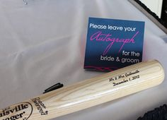 A custom engraved Louisville Slugger makes an awesome guestbook!