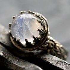 moon stone in a crown ring.