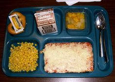 School pizza. At my school the breakfast pizza was rectangle, and the lunch pizza was a roughly triangular shape. And it always came with corn.