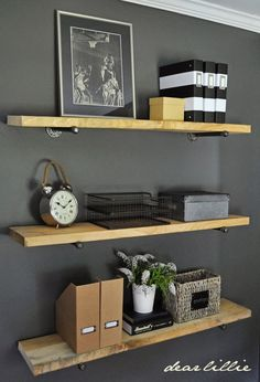 Masculine shelf styling for a teen boy's room with DIY industrial Restoration Hardware inspired shelving (wood shelving on galvanized pipe).  Wall color is Kendall Charcoal by Benjamin Moore.