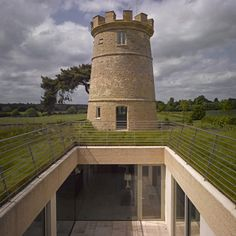 The Round Tower, De Matos Ryan.  Subterranean new house keeps landscape and tower pure and unadulterated.