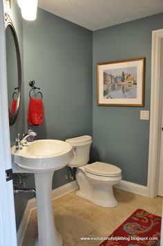 "New bathroom wall color? Mountain Laurel by Benjamin Moore.  Possible bathroom paint color to go with grayish blue tile? Nice red accents to relieve the ""dullness"" of gray, white, and biege... http://www.bathroom-paint.net/bathroom-paint-color.php"