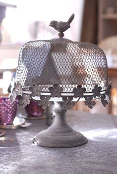 I want it!  Gorgeous cake stand with little flowers and a wire mesh cover topped with a little bird -- so pretty for cakes or cheese.