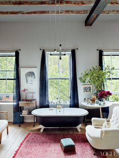 great room.. love the chic navy tub.
