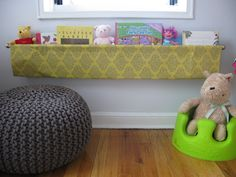 DIY Book Sling (made with fabric, dowels, double curtain rod and iron adhesive) #nursery #kidsroom