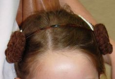 Princess Leia hair bands :)  Make 2 braids using yarn, roll each braid into a bun (sticking with hot glue gun as you roll) and then stick buns to both sides of a dollar store headband (with hot glue gun)... easy and so cute!  :)