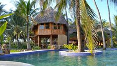 El Salvador Multisport Trip: Steps from the surf, Tortuga Village Resort has a rustic, tropical look and private pools.