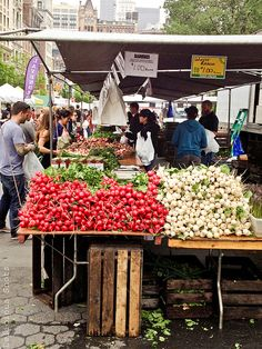 Buy vegetables at a farmers market. Who needs grocery stores? Fresh produce markets on almost every corner!