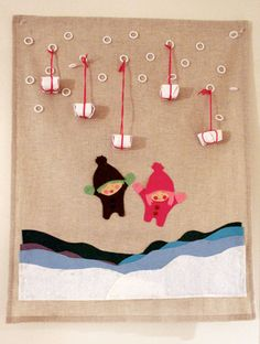 fabric advent calendar with tied on gifts