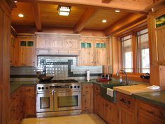 Mission style kitchen in a post and beam home by Vermont Custom Cabinetry