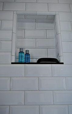 White Subway Tile Niche With Black Granite Shelf