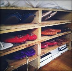 So cool! These are cargo crates used as a box spring that also serve as shelves for shoes.