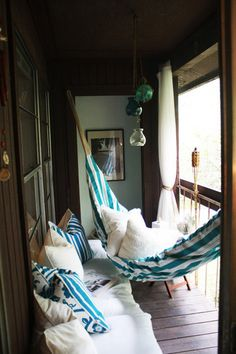 Tiny balcony - Cozy small space - Blue and white and brown - hammock