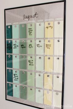 D.I.Y. project: Find a frame from the dollar store, use paint swatches for the background colors and layout a calendar format. Then use dry erase marker on the glass.