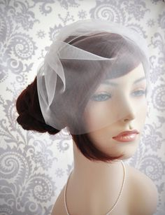 "Wedding Veil - Bridal Veil, Birdcage Veil ivory, Tulle Birdcage Veil, Blusher Veil, ivory, white, off-white, champagne, 11"". $35.00, via Etsy."