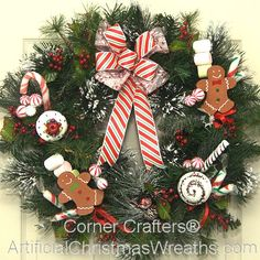 Holiday Bake Shop Wreath - 2013 - Frosted Cupcakes, Gingerbread Men, Candy Canes, Marshmallows, Frosted Pine Tips, colorful Berries, and a beautiful Candy Cane striped Bow adorn this spectacular wreath that will add a decorative warmth to your home all winter long. - #ChristmasWreaths #Christmas #Wreath #ArtificialChristmasWreaths