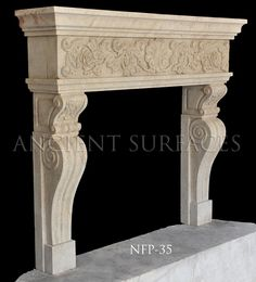 New hand carved fireplace mantels out of French limestone.