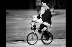 John Whiteriver rides an unusual bicycle to his job as a Santa in downtown Whittier. Perhaps his reindeer had the day off.