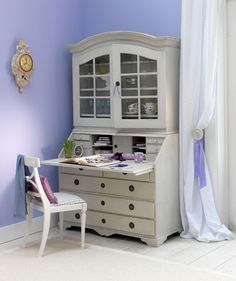 Not only does a charming armoire act as a hefty storage cabinet for stashing china, stemware, and silverware, but it also works overtime as a desk.