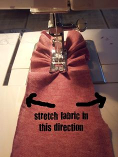 how to sew a ruffle on t-shirt fabric...stretch out sides while pushing forward.