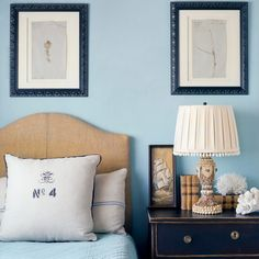 I love the headboard, looks like it's wrapped rope or twine AND I love the navy bedside table distressing.