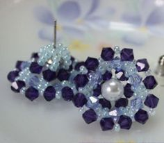 Crystal earrings are pretty, but these Stunning Snowflake Earrings also have pearls, making them extra special. Purple, periwinkle, and powder blue beads are just the right hues to set off the white pearl in the center of each earring.