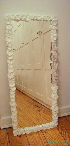 DIY: Easy Mirror Makeover  $5.00 Walmart Mirror, Hobby Lobby Flowers and Hot Glue!  SO cute!