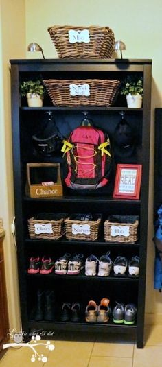Bookcase turned mud closet... perfect when you are short on space!