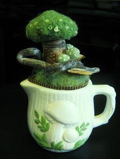 Felt pincushion.  What a brilliant idea for upcycling old ceramics!