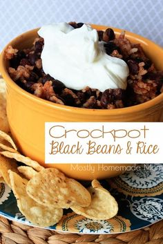 Crockpot Black Beans & Rice - Black beans, salsa, uncooked rice cook away in this crockpot side dish, perfect for chips or as burrito filling!