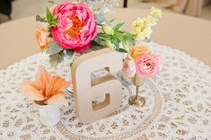 Vintage pink and peach centerpiece with lace // See more: http://theeld.com/1zhhufe