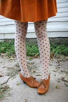 Those shoes.....that blazing burnt orange skirt....not many of us could wear this color, but what cheek this is!
